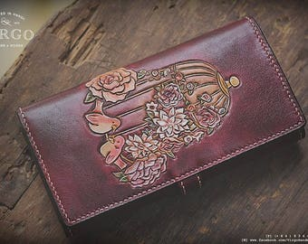 Hand tooled/carved wallet with bird and flowers