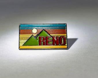 """1"""" x .5"""" enamel Reno Pin"""