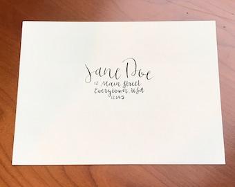 Custom calligraphy envelopes: black on cream