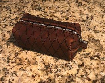 Full grain leather drop bag custom diamond stitch.