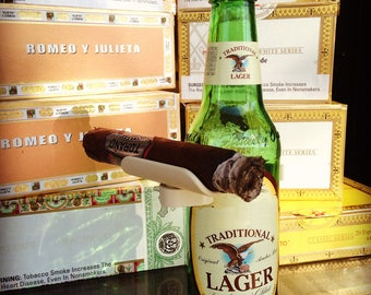 CigarzUp easily clasps onto your favorite cold beverage (Beer, Water, Soda ) and minds your cigar.