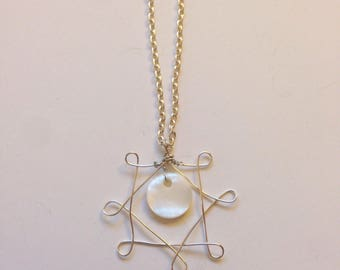 Full moon shell pendant