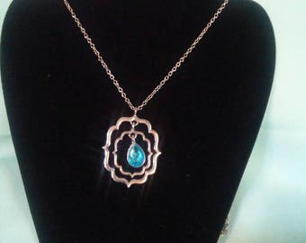 Pendant with blue stone on silver chain