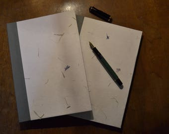 Notebooks with dried flowers