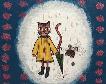 A Cat In a Raincoat