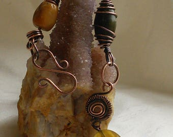 Jadeite, aged copper wire links and spirals with other stones will make you feel like a gypsy
