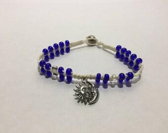 Hemp Beaded Bracelet with Cobalt Blue Beads and a Sun and Moon Charm