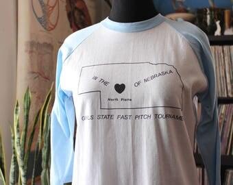 80s vintage Nebraska raglan sleeve baseball t-shirt . girls state fast pitch softball, North Platte NE . APPROX size womens xl