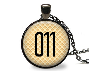 Stranger Things 011 with Waffle Background Pendant Necklace or Key Chain in choice of Silver, Bronze, Copper or Black Bezel