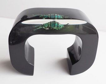 Art black lucite cuff bracelet with real exotic beetle