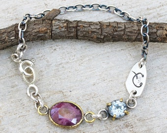 Bracelet,Ruby in brass bezel setting with blue topaz secondary gemstone and oxidized sterling silver chain
