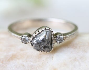 Natural rough diamond ring in textured sterling silver band and twin side set diamond gemstones