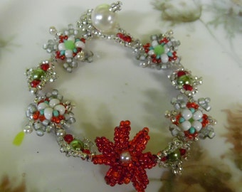 tinsel town christmas bracelet with poinsetta snoflakes tinsel