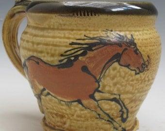 Mug with slip trailed horses handmade pottery