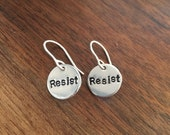 Resist charm tag on sterling silver earring hooks stamped aluminum circle
