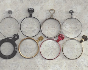 8 Vintage Silver, Brass and Other Colored Optical Lenses or Monocle type lens