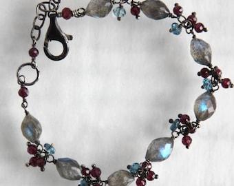 Labradorite Bracelet with Garnets and London Blue Topaz in Oxidized Sterling Silver