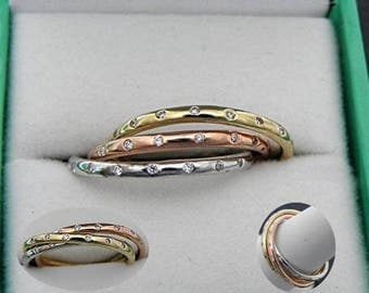 Spinning Rings 14K Tri Color Gold Rolling Trinity Diamond Wedding rings.  Set with 48 Diamonds 2mm (.35 Cts TW.)