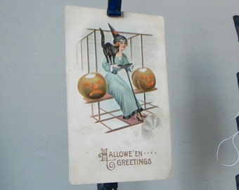 Vintage 1914 Halloween post card witch sitting on old fashioned airplane jack o lanterns blue dress orange Wright brothers style airplane