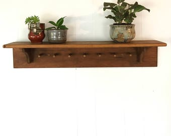 antique wooden peg rack - handmade brown wood shelf - coat hat wall storage