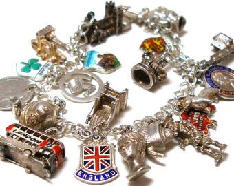 England UK 24 silver charms bracelet, Queen Elizabeth, Sterling, fully loaded. United Kingdom themed.