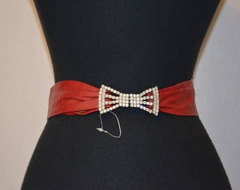 Vintage Glove leather cinch belt by Ruza. Rhinestone bow buckle set. Evening Deadstock.  28 waist or less. Red leather 80s 90s