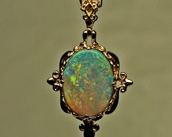 Medieval style opal setting in 18K gold. Australian semi black, crystal, Lightning Ridge stone. Chain not included