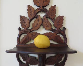 Antique Carved Walnut German Black Forest Hanging Shelf Leaf and Vine Motif