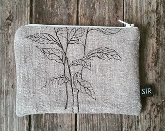 Handprinted pouch with pen drawing
