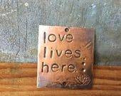 love lives here - warm copper passages plaque