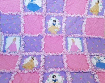 Disney princess blanket. Beautiful pink and purple flannel rag quilt for baby girl with sweet roses, flowers, and polka dots.