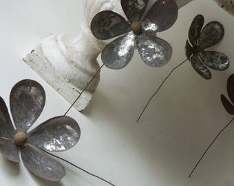 four vintage rusty tin flowers