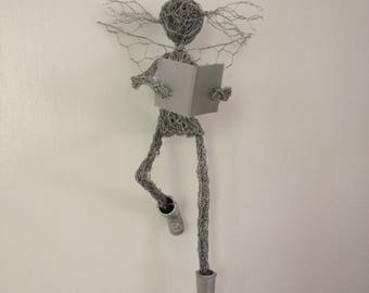Wire garden fairy reading a book