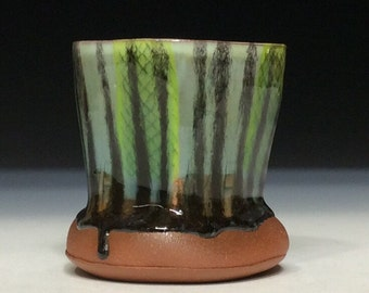 Striped tumbler with smooth glaze