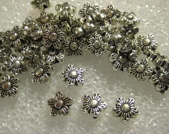 Tibetan Silver Daisy Spacer Beads, Top to Bottom Holes, 7mm x 3mm -- 40 beads