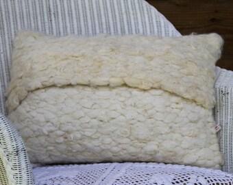 Woven felted cushion