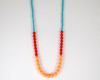 Coral red and turquoise colorblock necklace