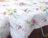 Vintage Oleg Cassini red, blue, and yellow oval floral tablecloth.