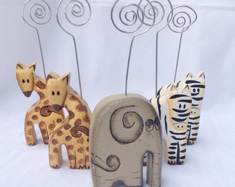 5 vintage wood animal placecard name card holders. 2 giraffe, 2 zebra, and 1 elephant.