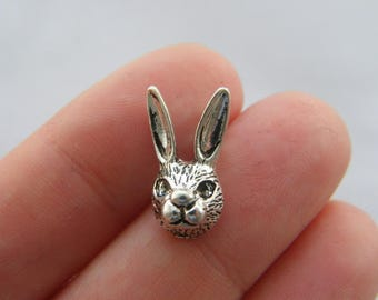 6 Rabbit charms antique silver tone A269