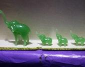 4 glass elephants