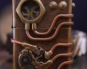 Steampunk brass lighter with copper brass and watch parts.