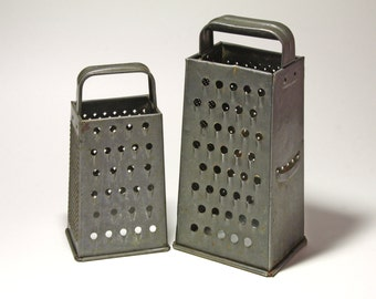 Vintage Set of Two Box Metal Graters with dark Patina - circa 1920's