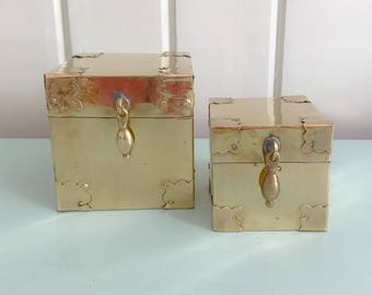 pair of brass square boxes