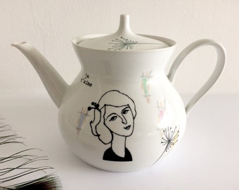 Vintage teapot with French lady Antoinette