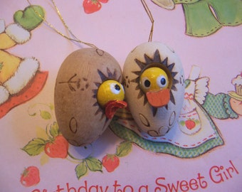two hatching wooden eggs