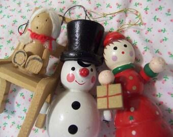 three random vintage wood ornaments