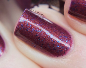 "Nail polish - ""LE 46""  blue multichrome flakies in a dark purple jelly base"