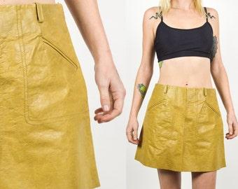 90's TAN LEATHER A-line Mini Skirt. High Rise Waist. A Line Cut with Pockets. 90's Grunge Mod. Hippie Disco LEATHER Skirt. Size S/Medium