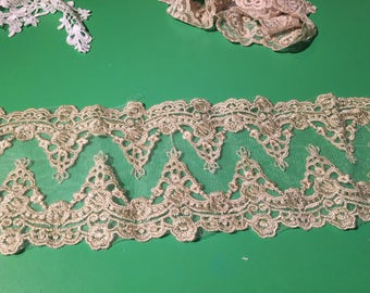 Gold double edge scalloped lace.
